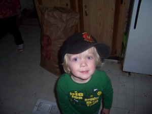 wearing Daddy's fire station hat