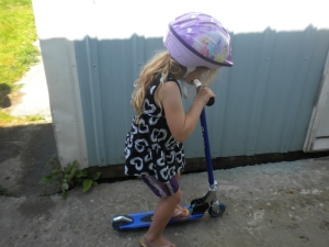 riding her new scooter