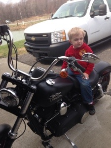 sitting on his uncle's bike