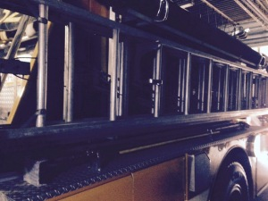 An extension ladder on the side of one of our trucks. Photo taken by me.