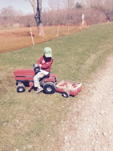 "he ""had"" to have his ""John Deere farmer"" hat on while he rode his (Farmall) tractor."
