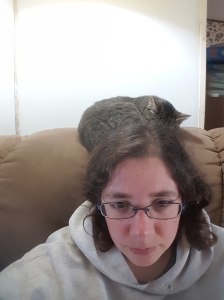 The cat seems to enjoy laying right behind my head then gets irritated if I dare to touch her.