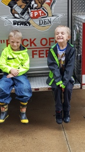 Hanging out on the fire truck with a friend.